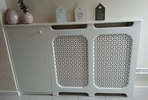 home made furniture. / Ombouw van de verwarming bij mijn dochter in limburg met een kast er naast.
