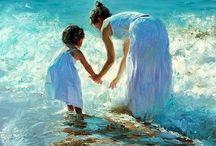 mamma con bimba in riva acqua. Vkadimir Volegov