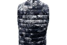 FOIL CAMO GOOSE DOWN VEST / SKU: OF15MO109V  Ultra light camo shadow vest with Goose down insulation. Insulated goose down provides warmth and comfort.  MULTI