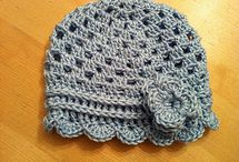 Crochet mittens and hats.