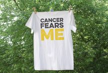 Charity Fundraising Items / Each month we raise awareness for a different cause. We design custom shirts, totes, pillows, and more and donate proceeds from the sales to a charity.   September - Childhood Cancer   October - Breast Cancer  November - Prostate Cancer