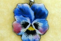 """Pansy Flowers - Vintage Charms & Bracelets / Silver & enameled Pansy Charms. In the """"language of flowers"""", pansies - their name derived from the French pensee' or """"thought"""" not surprisingly meant """"thoughts"""" or """"thinking of you"""". Also, not surprisingly, it was the favorite flower pin in late Victorian times. The pansy itself is lovely and its sentiment beyond reproach."""