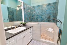 Carlsbad Caribbean Sanctuary / The tranquil beachside design theme flows through our client's seaside Carlsbad home as we crowned the master and guest baths to fit right in. The Master bath is adorned with Caribbean blues, weathered plank style porcelain tiles, pebble shower pan, custom accents and all comes together to make this calming sanctuary perfectly balanced.   The guest bathroom has the grey of the beachy sands.  Casual and comfortable.   www.signaturedesignskitchenbath.com