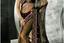 Indian Dresses / Indian dresses carry an age old tradition. They are ethnic in style yet fashionable enough to compete with any type of western style.   The workmanship, embellishment and design can be mesmerizing. Some of the typical outfits are Sarees, Salwar, Anarkalis and lehengas for women and kurta, sherwani and Dhoti for men.  This board tries to showcase some of the latest trending costumes.