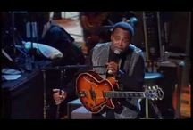 George Benson / George Benson (born March 22, 1943) is a ten time Grammy Award winning American musician, whose production career began at the age of twenty-one as a jazz guitarist. Benson first came to prominence in the 1960s playing soul jazz with the likes of Jack McDuff. Benson then launched a successful solo career, alternating between jazz, pop, R&B singing, and scat singing.