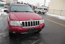 Used 2004 Jeep Grand Cherokee for Sale ($4,499) at Paterson, NJ / Make:  Jeep, Model:  Grand Cherokee, Year:  2004, Body Style:  Tractor, Exterior Color: Red, Interior Color: Black, Vehicle Condition: Excellent,  Mileage:163,000 mi, Transmission: Automatic, Fuel: Gasoline Hybrid.   Contact:  973-925-5626   Car ID (56689)