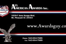 """Awards Board / All American Awards provides custom awards in the Charelston area (Mt. Pleasant).  Along with crystal awards, trophies, plaques, name badges, signs, and banners, we also have novel awards like """"when pigs fly"""", """"recreating the wheel"""", """"building a better mousetrap"""" and an assortment of others."""