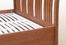 Tömörfa ágy / Hálószoba-bútorok gyártása az egyik fő profilunk, az elmúlt években számos ágykeret-modellt hoztunk létre, és ágyak százai kerültek ki üzemünkből. A hálószoba-garnitúrák az ágykeret mellett éjjeliszekrényt, komódot tartalmaznak, illetve különböző nagyságú és funkciójú szekrény tartozik még ebbe a termékcsaládba.