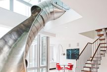 Cool Metal slide in East village penthouse / The half-tube, sculptural slide begins on the top floor of the 18-foot-tall atrium that has custom-designed glass railings and lands on the floor below near the living and dining rooms. It curves alongside the expansive windows, providing a city view on the way down. Thanks to http://www.6sqft.com/