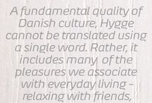"Hygge Home / In Danish, hygge (pronounced ""HUE-gah"") is one such word. Though there are many ways to describe hygge, we see it simply as the Danish ritual of enjoying life's simple pleasures. Friends. Family. Graciousness."