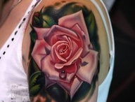 Tattoos & Piercings / by Jessica Boswell