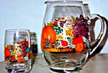 Thanksgiving Glasses, Glassware and Thanksgiving Dinnerware Pieces / Hand painted Thanksgiving glasses in a vibrant fall design with pumpkins, grapes, cabbages, pomegranates, Indian corn, apples, squash all etched in gold leaf. Why not have other pieces of Thanksgiving dinnerware hand painted to match.  http://goo.gl/TwRIvi