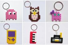 Perler Bead Patterns / Small, colourful, fusible plastic beads (some brands are Nabbi, Hama, Perler, and Pyssla) can be placed on a peg board in different designs and then melted together with a clothes iron.  The resulting piece can be made into coasters, jewelry, etc.