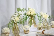 Corporate Styling, Gambaros Hotel & Restaurant / Framed in a base of crisp white, the gold accents were highlighted dramatically in this recent Queensland Brides Wedding & Honeymoon Expo. From Gold Cutlery, Gold Tiffany Chairs, Gold Rim Glass Charger Plates with stunning white roses and florals cased in mottled gold mercury vases, it certainly showcased the Gambaros Hotel & Restaurant as an Function Venue that exudes opulence & style. Youtube: https://www.youtube.com/watch?v=E7UEpmNjkZ0&feature=youtu.be