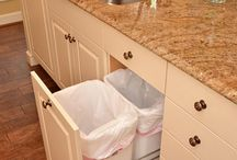 Cabinet drawer for waste with drawer above, storing rubbish bags
