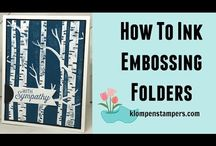 Embossing folders with ink