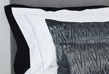 Grey & White Bedroom Ideas / Mixes of tone and texture in grey - from silver grey edged fine cotton bed linen to Cambodian Silk Ikat cushions.