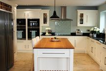 In-Frame Painted Kitchen / Stunning tulip in-frame kitchen by Steven James Kitchens with granite nero absolute worktop and island unit with Oak top.