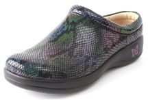 Alegria Kayla / This slip-on shoe features a patent leather, Napa leather or printed leather upper. A breathable, moisture-wicking leather lining and soft, suede sock liner keeps the foot cool and dry, while the removable, anatomically correct Alegria insole conforms to the foot to offer individual fit and cushioned comfort. The lightweight, polyurethane midsole reduces heel and metatarsal pressure. The outsole has a flat bottom with a slip resistant sole to keep you on your feet. / by Alegria Shoe Shop