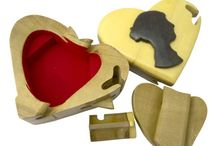 Timber-Treasures Jane Austen puzzle box / These cleverly designed puzzle boxes are a secure place to store small valuables, with their secret locking mechanism. Hand crafted in the style of a heart, decorated with a Jane Austen silhouette, the intriguing locking sequence keeps secrets secret. Flock lined interior. External dimensions - 13 x 11 x 6 cms* Internal dimensions - 7 x 6 x 1.5 cms* *handmade disclaimer