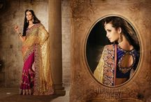 Bridal Saree's / Bridal Wear designer traditional Saree's with superb work en-crafted all over along with contrast Blouse.