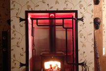 Fire place with a nod to the original build design. / Modern multi fuel stove in a Traditional inglenook.