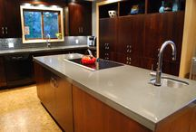The W Family's Kitchen / Burnt ash with maple accents..this truly is a modern look to envy. Love that solid surface counter top...such storage, amazing design and timeless style!