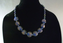 Pretty costume Jewelry / I found this fantastic blue glass and sparkles beaded necklace on Etsy.  you can find it at http://www.etsy.com/listing/92404480/contemporary-murano-glass-bead-necklace