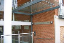 Trinity Gate - Case Study / Point Fixed Vertical Structural Glazing, Glass Canopy and Frameless Glass Doors have been used within this case study.