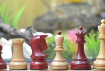 """Reproduction 1950 Dubrovnik Bobby Fischer Chess Set in Stained Crimson / Box Wood - 4"""" King / Our reproduced Dubrovnik weighted chess pieces with crimson stain comes with a 4"""" King height and base diameter of 1.77""""."""