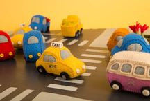 Cars, Trains and Automobiles / Jump into our vintage rides and check out our collection of fun and brights cars trains and automobiles! These little guys can help you commemorate a great road-trip, or your kid's first car! Beep Beep! Looks bright and merry on the tree