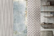 Gritty Chic / Adding an edge to interiors, tile companies continue to experiment with plaster, concrete, metal and resin. Some designs are elegant interpretations of industrial surfaces, offering a kind of raw sophistication, while others are intentionally corroded and weathered, conjuring a romantic notion of the passage of time.