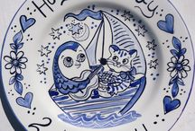 Blue & White hand painted plates / Blue and white pottery has ancient roots in China and was introduced to Europe in the 17th century where it was highly prized. Meissen and Delft developed their own styles and in Britain the Potteries produced the famous Willow Pattern. Kate continues that long tradition of blue and white ceramics with her own personal style and inspiration. You can commission a blue and white plate for any occasion, from birth through to retirement, and have it personalised according to your exact requirements.