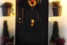 My House outdoor decoration details / I love to laborate with items and colours on my house entree The black doors is my new addition and it makes fun to combinate it with decorations in gold which I have fixed myself