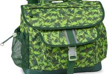 Dino Camo Collection / With the Dino Camo collection, your child's imagination will never go extinct. Hunt for a t-rex, triceratops, or stegosaurus on these fierce backpacks, duffels and lunchboxes. With style of Jurassic proportions, he'll be King of the Triassic period—or at least, the lunch period.