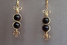 Earrings / by Nancy DeJesus