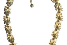 Arabella's Vintage Necklaces / Vintage necklaces, collars and pendants. Including real gold and signed pieces. There are also some colourful plastic beads.   Beautiful vintage necklaces to be worn today, from a bygone era.