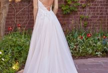 Baby got Back / Give them something to look at while you're standing at the alter! A stunning back makes a statement and we love all of them: backless, thin crossing straps, illusion backs, intricate lace designs, etc. All featured wedding dresses are available for purchase at Weddings with Joy, located in Olympia, Wa.