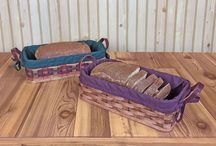 Bread Baskets / Our collection of bread baskets will compliment any kitchen. Available in assorted sizes and colors, each basket features vintage styling that will receive many compliments from your friends and visitors.
