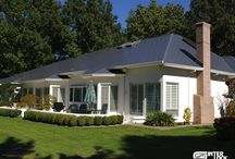 Metal Shingle Roofing / Interlock® Shingle roofing is a four way interlocking aluminum roofing system. Each shingle is embossed with a heavy grain texture, coated with the Alunar® Coating System embedded with TEFLON® surface protector to provide an extremely durable and attractive surface. Available in your choice of designer colors.