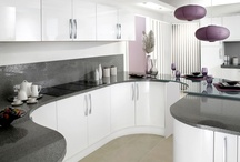 Contemporary Kitchen Tips / To achieve this look: Handleless, high gloss, feature walls, streamlining, acrylic, vertical space, room division, large curved islands, bright vivid contrasting colours, open plan, glass splashback,  minimal accessories, stainless steel, dark wood, match units with accessoriesm, natural lighting, multi spotlights.