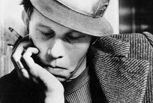 """Tom Waits / Thomas Alan """"Tom"""" Waits (born December 7, 1949) is an American singer-songwriter, composer, and actor. Waits has a distinctive voice, described by critic Daniel Durchholz as sounding """"like it was soaked in a vat of bourbon, left hanging in the smokehouse for a few months, and then taken outside and run over with a car.....but, there is just something about him. / by Peggy Kolakoff"""