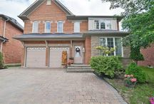 Real Estate Listing - 15 EDELWEISS AVE RICHMOND HILL, ON / Absolutely Stunning Home On A Premium Lot With Spectacular Unobstructed Pond & Tree View With 9 Foot Ceiling.W/O Basement Huge Master Br,En Suite W/I Closet In Master & 2nd Br.Hardwood Thru Out.Extended Windows On Main Floor 2 Skylights,Interlocked Driveway & Large Deck.2 Basement Apt With Earning $1600 Per Month.Do Not Miss Out This Gem.