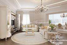 Классический интерьер квартиры в ЖК Волынская Усадьба / Дизайн квартиры в ЖК «Волынская Усадьба» спроектирован в классическом стиле. В ней прослеживается роскошь и эргономика. В квартире есть просторная гостиная, которая располагает для встречи гостей и долгих бесед. Она открытого типа и совмещена вместе со столовой. В интерьере преобладают светлые тона, которые зрительно увеличивают пространство.