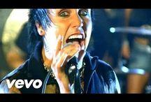 Trey Mills / Rhythm Guitarist of Sinner,a fictional rock band
