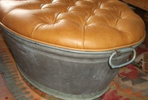 Old rusty galvanized tub is repurposed as a functional ottoman.