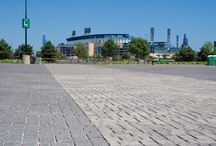 "Set the Stage at Stadiums with Concrete Pavers / Many civic centers and stadiums use concrete pavers as the entry ""stage"" for sporting events and concerts. Concrete pavers help create a sense of human scale in large plazas and stadium facilities."