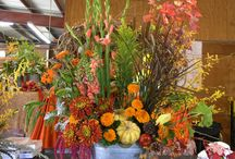 Fall Flowers / The fall season is full of rich colors of gold, orange, reds and deep burgundy.  A time of the year where grasses, pumpkins and leaves are used in our designs.  Our flower designs show the abundance of the fall harvest.