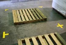 Floor Markers: Corners, T's, X's, Dashes, Arrows, Dots, Footprints / Showing the various ways that floor markers can be used to organize floor layouts. For example, marking out work cells, pallets, storage areas, and equipment. Marking the floors of industrial facilities in a way that increases efficiency is part of Lean Manufacturing initiatives.