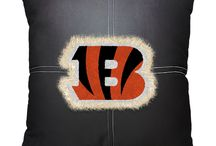 Cincinnati Bengals NFL / Cincinnati Bengals Merchandise is an awesome way to decorate your home & office to create your own Vikings fan zone in your bedroom, kid's bedroom, game room, study, kitchen, living room, and even the bathroom. Also magnificent as Cincinnati Bengals fan gifts. Bengal Nation - Show off your team spirit today!